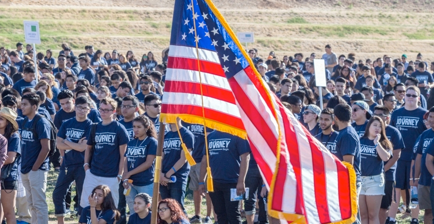 U.S. flag flies in front of UC Merced students